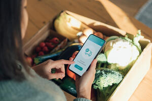 ey-young-woman-ordering-groceries-online-with-smartphone